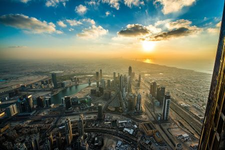By Simon Bierwald from Dortmund, Germany (Dubai Sunset from Burj Khalifa) [CC BY-SA 2.0 (https://creativecommons.org/licenses/by-sa/2.0)], via Wikimedia Commons