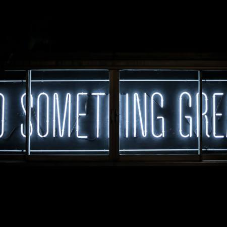 Neon sign saying 'do something great'