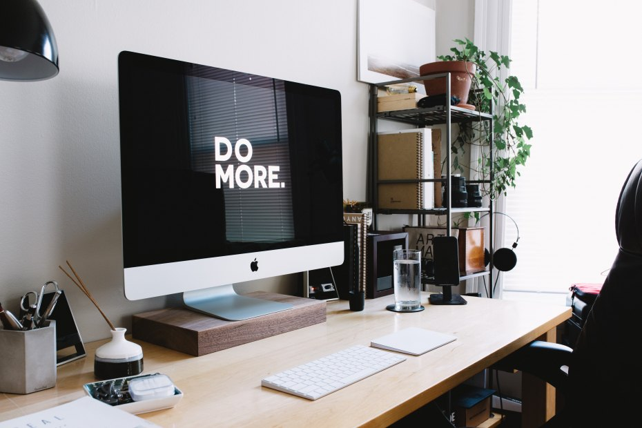 Desktop with computer monitor displaying the message 'Do More'
