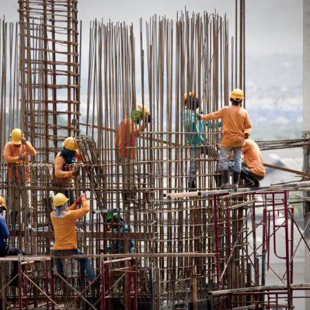 Image of migrant construction workers working on a building site